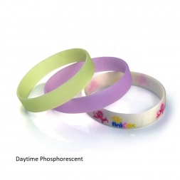 three phosphorescent silicone wristband on daytime white yellow and pink en